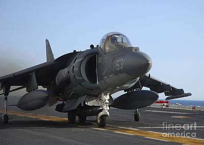 Av-8b Photograph - An Av-8b Harrier Launches by Stocktrek Images