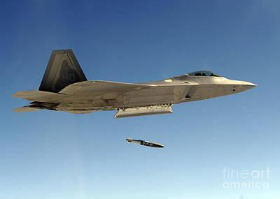 An F-22a Raptor Drops A Gbu-32 Bomb Print by Stocktrek Images