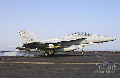 Braking Photograph - An Fa-18e Super Hornet Lands Aboard Uss by Giovanni Colla