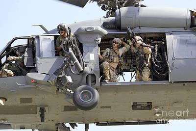 Outlook Photograph - An Hh-60 Pave Hawk Helicopter Crew by Stocktrek Images
