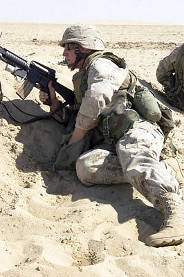 Infantryman Photograph - An Infantryman Takes Cover by Stocktrek Images