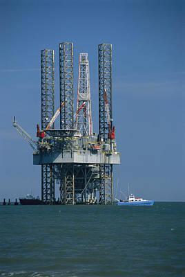 Cranes And Derricks Etc Photograph - An Oil Rig Under Construction by Raymond Gehman