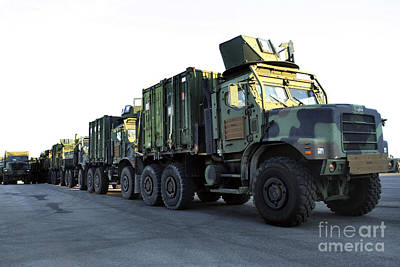 Tons Of Photograph - Armored Trucks Sit On The Pier by Stocktrek Images