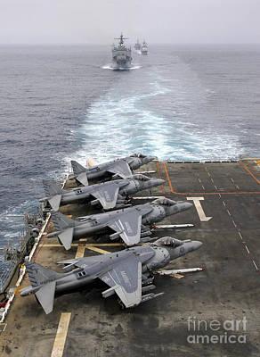 Av-8b Photograph - Av-8b Harriers Line The Flight Deck by Stocktrek Images