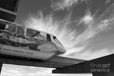 Magic Kingdom Photograph - Backlit Disney World Monorail Leaving Contemporary Resort Walt Disney World Prints Black And White by Shawn O'Brien