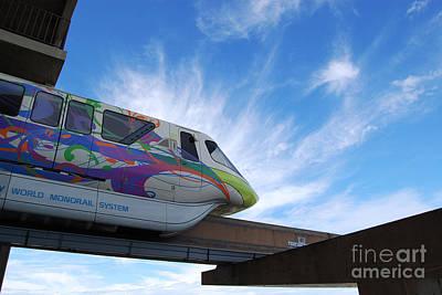 Magic Kingdom Photograph - Backlit Disney World Monorail Leaving Contemporary Resort Walt Disney World Prints by Shawn O'Brien