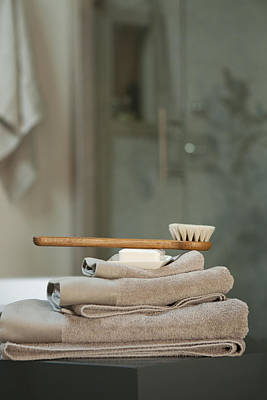 Domestic Bathroom Photograph - Bath Brush On Stacked Towels by Karyn R. Millet