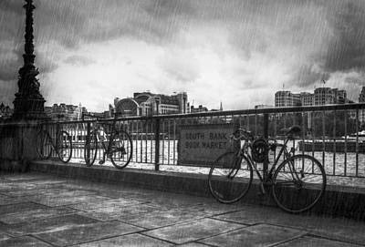 Rain Photograph - Bicycles On South Bank by Pete Luckhurst