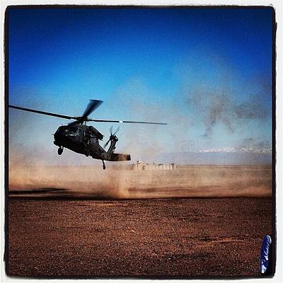 Helicopter Photograph - Black Hawk Landing In Afghanistan by Cody Barnhart