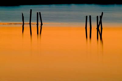 Black Pilings Orange Water Print by Rich Franco