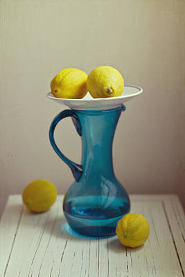 Lemon Photograph - Blue Pitcher With Lemons On White Plate by Copyright Anna Nemoy(Xaomena)