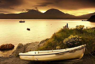 Islay Photograph - Boat On The Shore At Sunset, Island Of by John Short