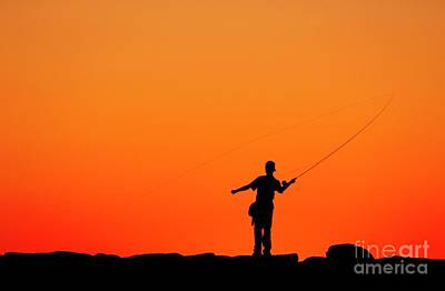 Boy Fishing From A Jetty Print by John Greim