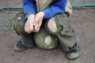 Pause Photograph - Boy Sitting On Ball - Torn Trousers by Matthias Hauser