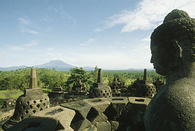 Carving In Stone Photograph - Buddha Statue At The Borobudur Stupa by Martin Gray