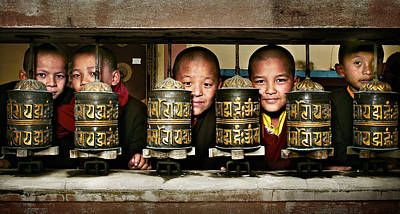 Buddhist Monks In Red Robes Look Out Of The Prayer Wheels With M Print by Max Drukpa
