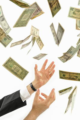 Businessman's Hands Trying To Catch Us Dollars Print by Sami Sarkis