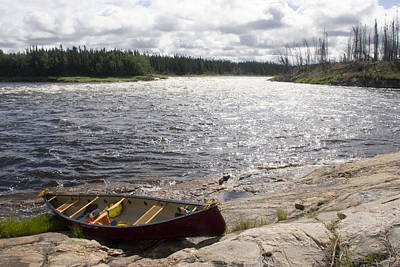 Canoe Pulled Up On The Shore Print by Skip Brown