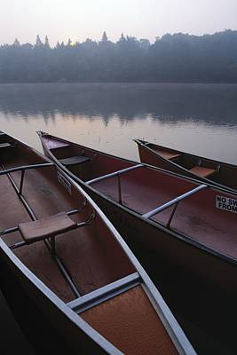 Canoes On Still Water Print by Natural Selection John Reddy