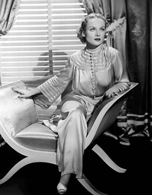 Carole Lombard, Sitting, In A 1930s Print by Everett