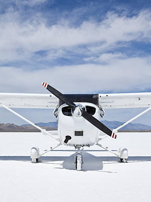 Cessna Aircraft On Bonneville Salt Flats Print by Paul Edmondson