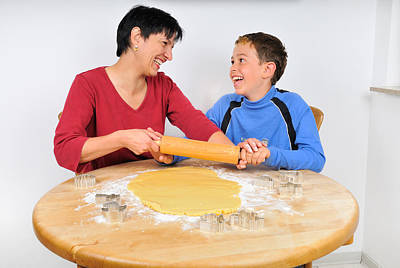 Christmas Photograph - Christmas Baking - Mother And Son Laughing by Matthias Hauser