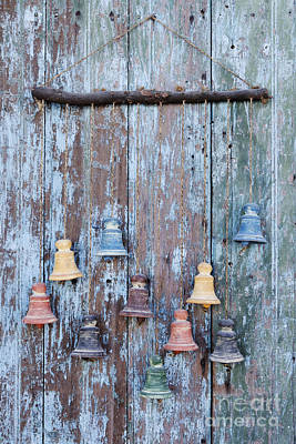 Clay Bells On A Weathered Door Print by Jeremy Woodhouse