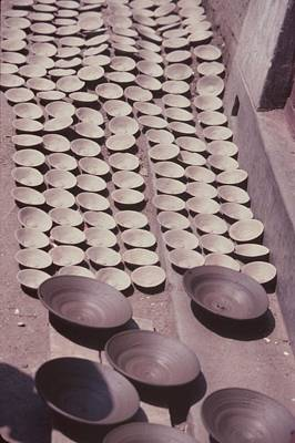 Hand Thrown Pottery Photograph - Clay Yogurt Cups Drying In The Sun by David Sherman