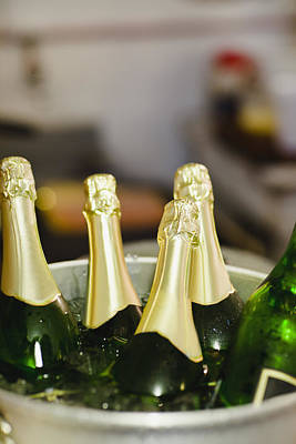 Images Of Wine Bottles Photograph - Close Up Of Bucket Of Champagne by Hybrid Images