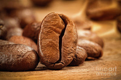 Closeup Shot Of A Coffee Bean On Wood Print by Sandra Cunningham