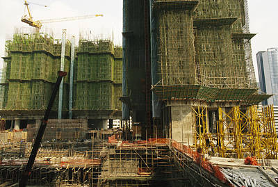 Cranes And Derricks Etc Photograph - Construction And Building Is Booming by Justin Guariglia