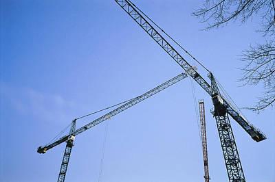 Cranes And Derricks Etc Photograph - Construction Cranes Stand by Stephen Alvarez
