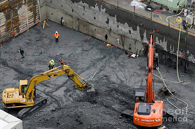 Construction Site Diggers And Workmen In The Foundation Pit Of A New Building Seattle Print by Andy Smy