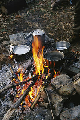 Cooking Over A Campfire On The Middle Print by Skip Brown