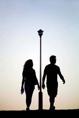 Couple Exercise While Walking At Sunset Print by Virginia Star