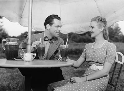Couple Having Ice Tea Outdoors, (b&w) Print by George Marks