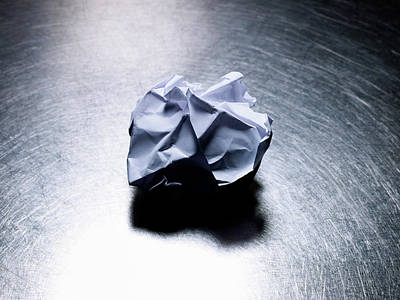 Crumpled Sheet Of White Paper On Stainless Steel. Print by Ballyscanlon