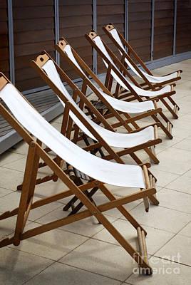Deckchairs Print by Carlos Caetano