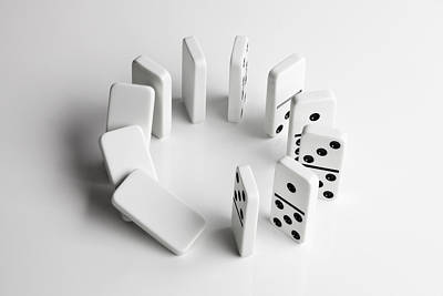 Balance In Life Photograph - Dominoes In A Circle Beginning To Fall Over In A Chain Reaction by Larry Washburn