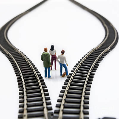 Considering Photograph - Figurines Between Two Tracks Leading Into Different Directions Symbolic Image For Making Decisions. by Bernard Jaubert
