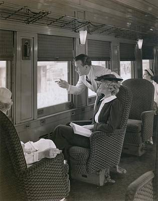 First Class Passengers In An Print by Everett