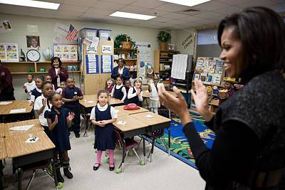 First Lady Michelle Obama Claps Print by Everett