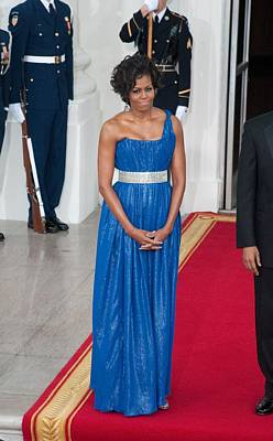 The Obamas Photograph - First Lady Michelle Obama Wearing by Everett