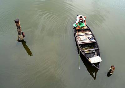 Crouched Photograph - Fisherman And His Boat by Pallab Seth