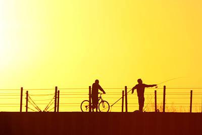 Fishing At Sunset Print by Dennis Pintoski
