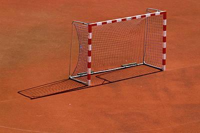 Football Net On Red Ground Print by Daniel Kulinski