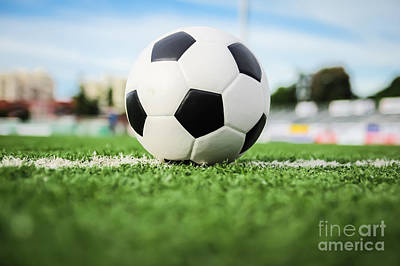 Football On Green Grass   Print by Mongkol Chakritthakool