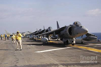 Av-8b Photograph - Four Av-8b Harrier Jets Line by Stocktrek Images