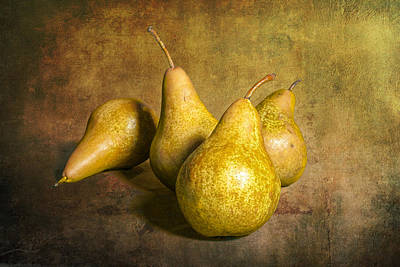 Four Pears On Warm Amber Background Print by Randall Nyhof