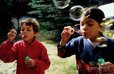 Girl And Boy Blowing Bubble-wands Print by Sami Sarkis